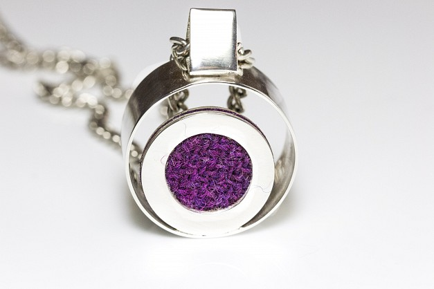Sterling Silver necklace on a long (40inch)chain with circular frame and Purple/Pink Harris Tweed